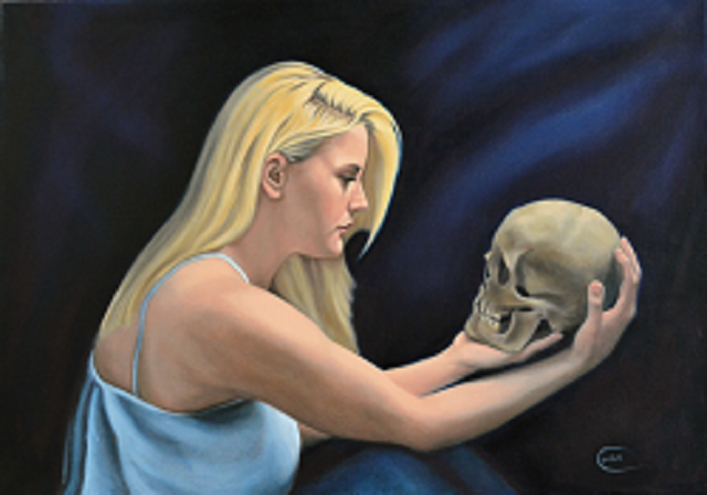 Portrait of woman with skull